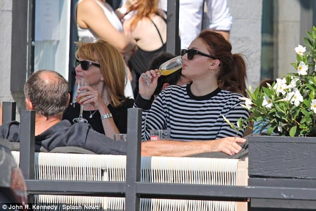 Letting loose: Sophie Turner, 21, continued to figuratively let her hair down as she enjoyed an alfresco brunch with her parents Sally and Andrew on Sunday in Montreal, Canada