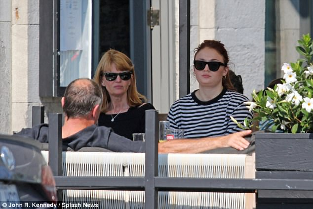 Resting: Sophie - who made her name playing Sansa Stark in HBO's fantasy drama Game of Thrones - complemented her stylish display by shielding her eyes with a pair of classic shades and small silver hooped earrings