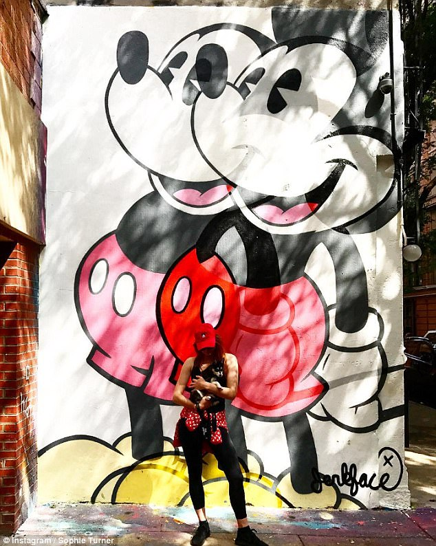 All ears:Last week, Sophie posted a snap to Instagram of herself in leggings and a Mickey Mouse cap standing in front of a Mickey Mouse mural in New York