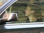 Chelsea Clinton was seen packing up her car with her husband and children as they prepared to head out into traffic
