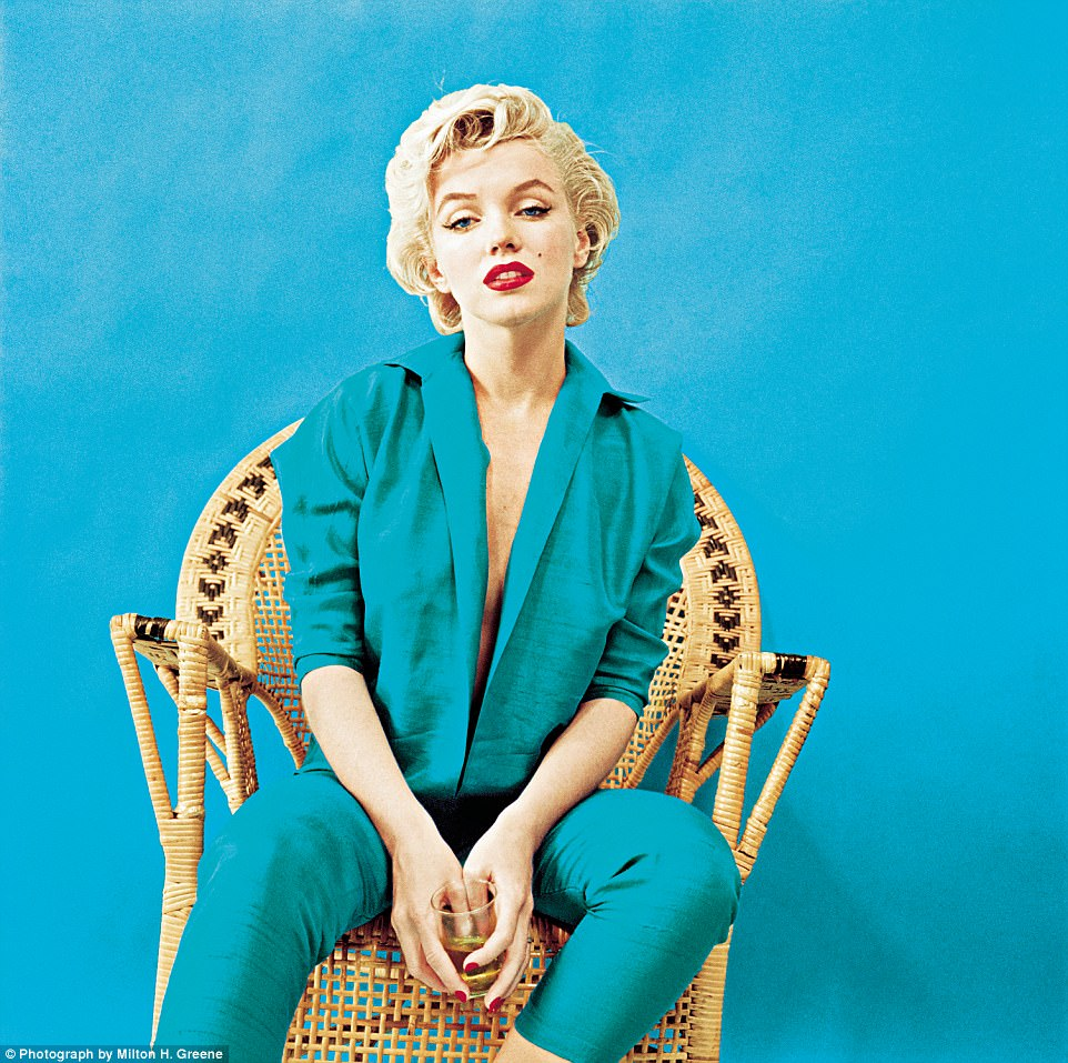 Lady swigs the booze:A pensive portrait, with a drink in hand, shot at Greene¿s New York studio in March 1955. The outfit was designed by Jax of Hollywood, and became a signature look for Monroe