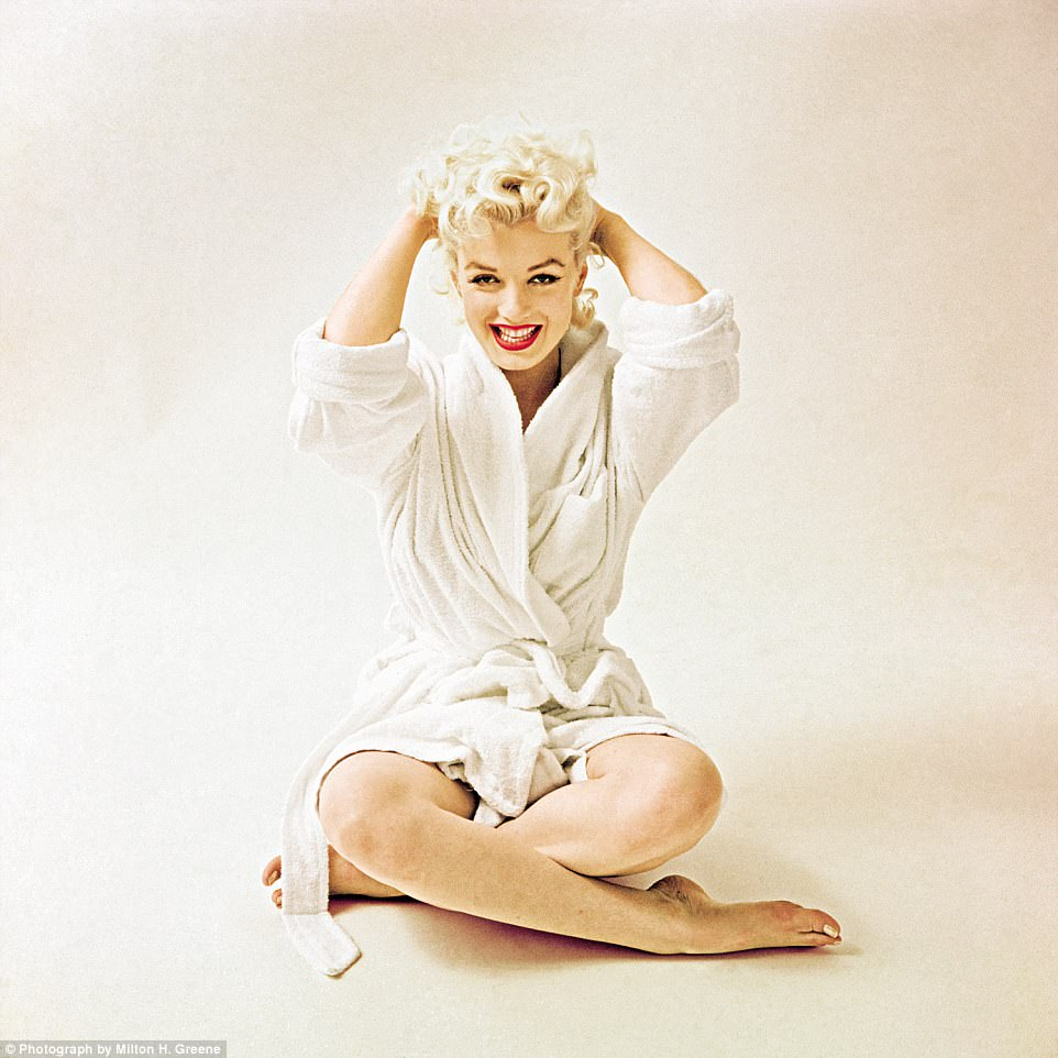 Good clean fun:Monroe had just finished her make-up in 1955 when Greene decided to shoot her right there, in her bathrobe