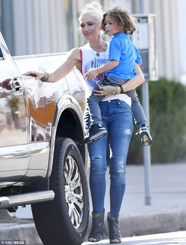 What a cutie: The gorgeous star toted youngest son Apollo Bowie Flynn during her LA outing