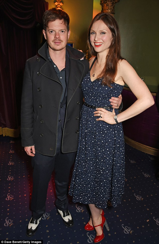 Cute couple:Sophie Ellis Bextor, 38. looked divine in a navy star-print strappy dress which she paired with red Mary-Jane shoes as she posed with her husband Richard Jones