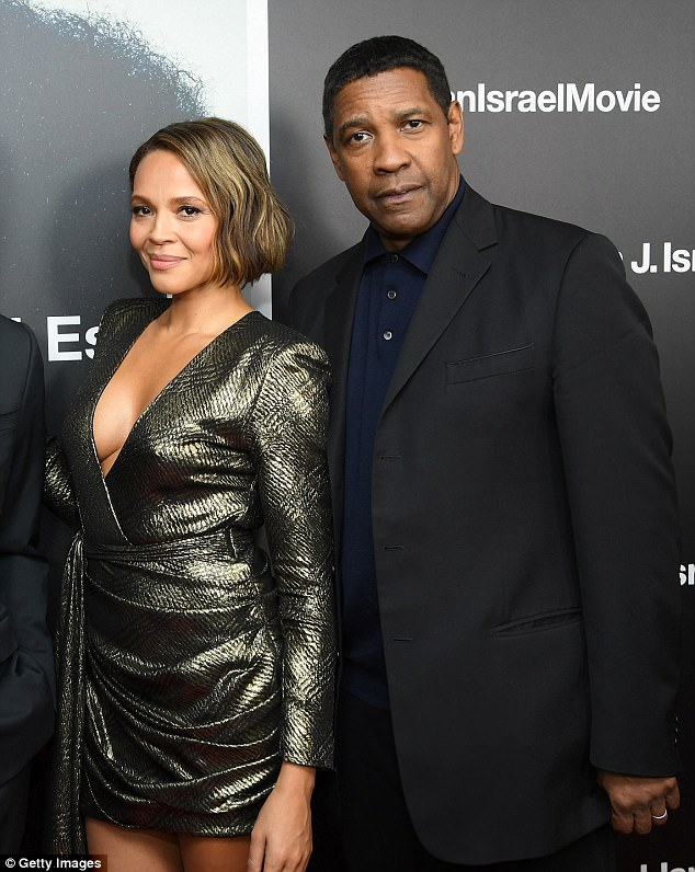 Co-stars: Denzel Washington and Carmen Ejogo were the center of attention at a screening in New York of their new movie Roman J. Israel, Esq. on Monday night