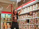 A topless activist of the feminist movement FEMEN bearing the slogan 'Black Friday' raids a shop in Ukraine this morning as consumer madness spreads around the world