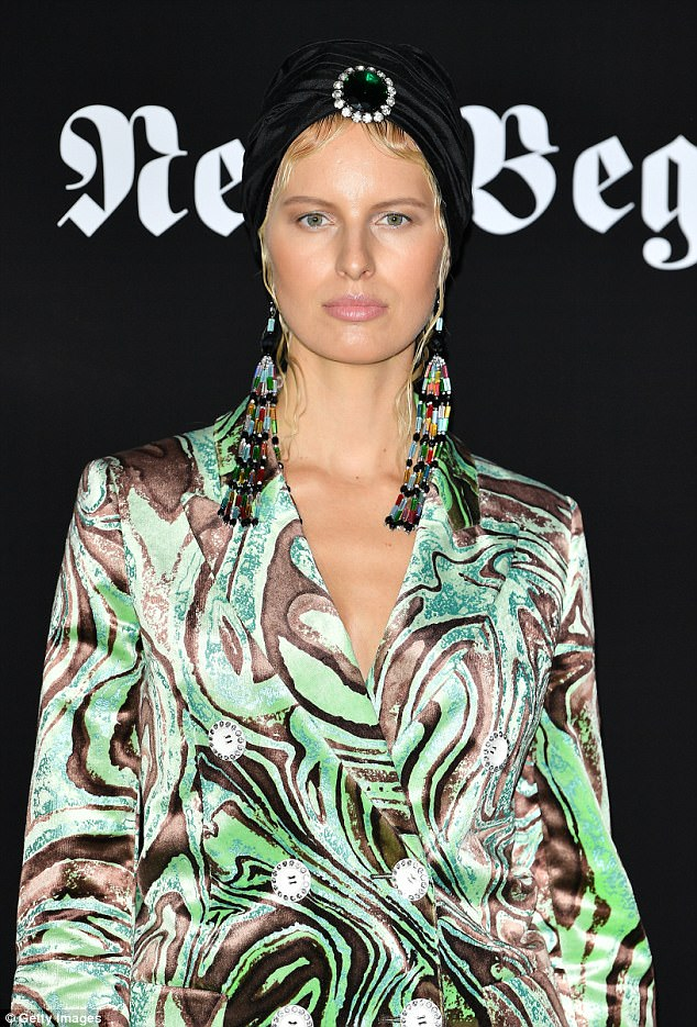 Shimmering: The Czech model, 33, opted for a green and black, buttoned suit with statement flares and a plunging neckline