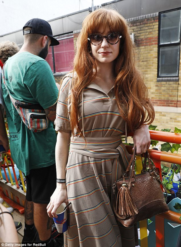 Why hello! Nicole Roberts also looked chic for Notting Hill in a striped dress which she teamed with a shiny brown handbag