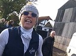 Ugly scenes: Jane Miller, whose partner partner is part of the UK's oldest family hotel dynasty, has been filmed in two videos clashing nastily with hunt saboteurs. In the first video she was filmed repeatedly whipping a protester wearing a mask who was grabbing her horse