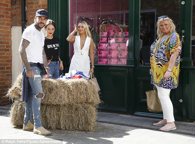 Taking charge:Leading lady Gemma was seen instructing her friends when it came to her party plans - clad in a printed kaftan top ad white jeans.