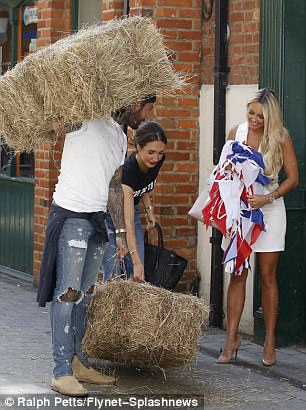 Personally delivered: They appeared to be taking the farm goods to the door of Gemma's boutique