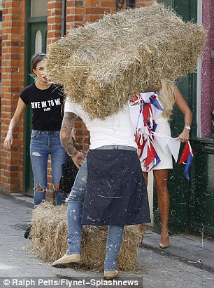 Messy work: Although it proved to be a struggle as a number of strands of hay were seen escaping