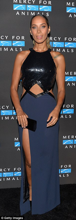 Slim: Leona's midriff looked minuscule, and a sultry thigh high slit exposed the entire expanse of her toned leg
