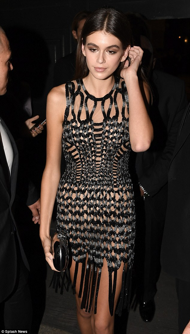 Teen sensation:Kaia worked a glittering tasselled dress as she attended the Versace after-party