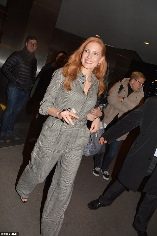 Stylish in grey: The actress was happy to sign autographs outside theMOMA museum wearing her chic shirt style jumpsuit and a pair of black sandal style heels