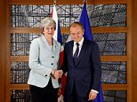 Theresa May has held talks about a potential referral system to the European Court of Justice for EU systems who choose to remain in the UK after Brexit. The Prime Minister is pictured with European Council President Donald Tusk during a bilateral meeting in Brussels yesterday