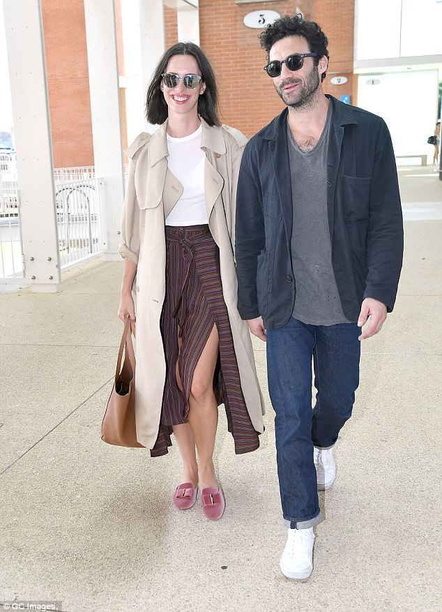 Jetting in: Rebecca Hall, 35, was all smiles as she arrived at Venice Airport with her husband Morgan Spector, 36, on Tuesday