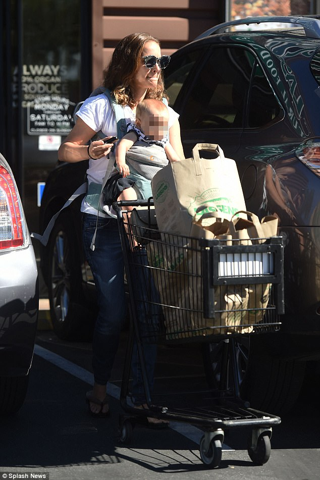 Loaded up: 36-year-old actress Natalie Portman stocked up on organic produce in Los Angeles on Tuesday