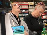 A pair of 'drugged-out' cashier clerks appear to be falling asleep at the register as they check out a man at what appears to be a gas station inSonoma County, California
