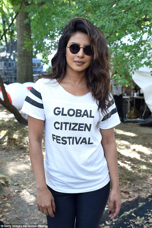 Relaxed:Offstage, she was seen in a more casual ensemble: a black and white Global Citizen Festival T-shirt - the same one Michelle wore - plus skintight navy trousers