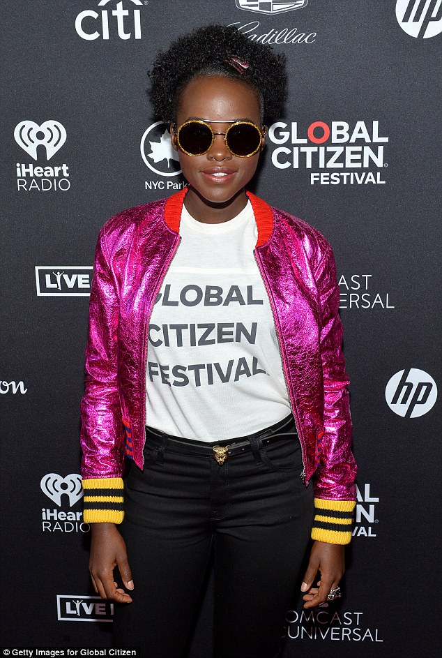 Radiant: A bright pink bomber jacket with a red collar - plus yellow and black striped cuffs - complemented the yellow-rimmed black shades she'd worn