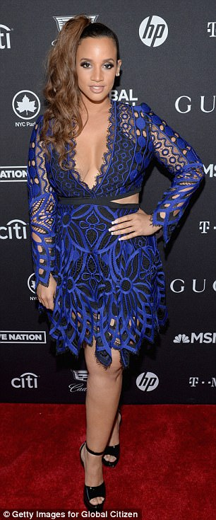 Posing up a storm: Dascha Polanco had pulled her hair into a lopsided ponytail that dangled down the right side of her face