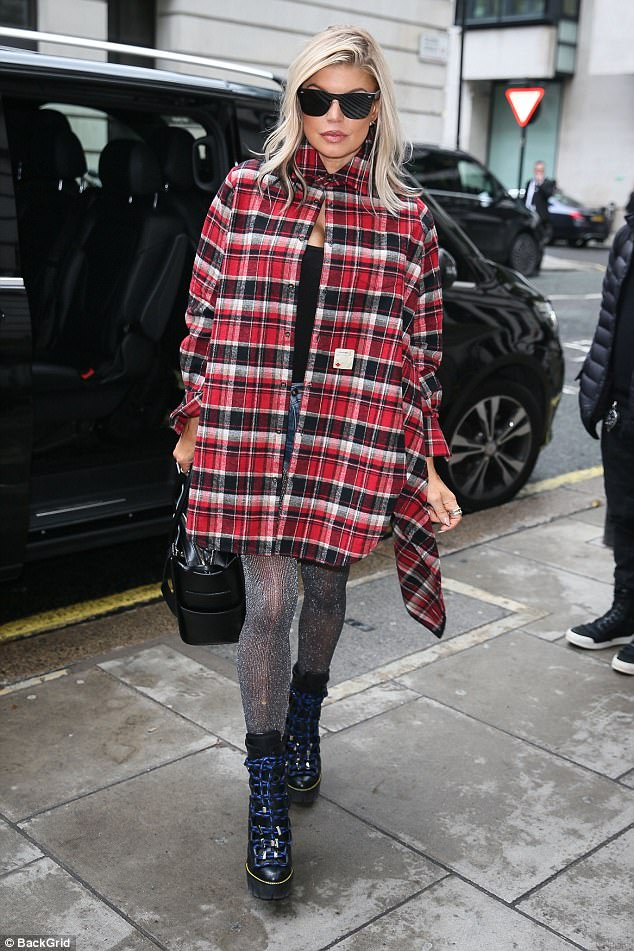 Turning heads! Fergie was later spotted leaving the studios in a checked red shirt