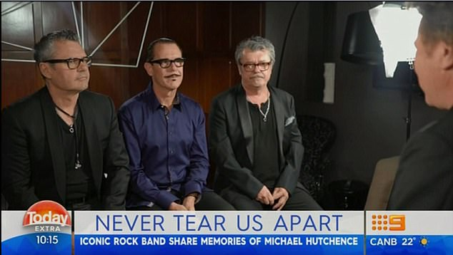 Still raw: With the 20th anniversary of Michael Hutchence's death this month, the surviving members of INXS have revealed they still struggle with his passing