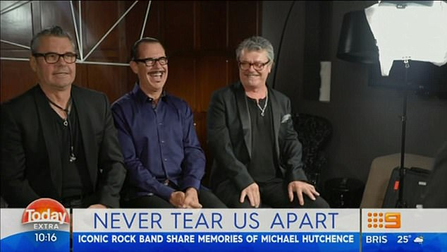 Good times: While Michael's passing still affects the surviving members, Kirk Pengilly (centre) was quick to add it was important to remember Michael for the fun, free-spirit that he was