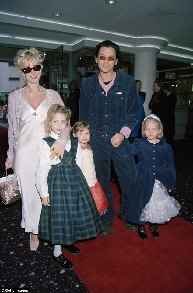 Family man: In the hours before his death, Michael had spoken by telephone to Paula, hoping she would visit Australia with their 16-month-old daughter Tiger Lily and two of her three daughters with Bob Geldof, ahead of the last leg of an INXS world tour