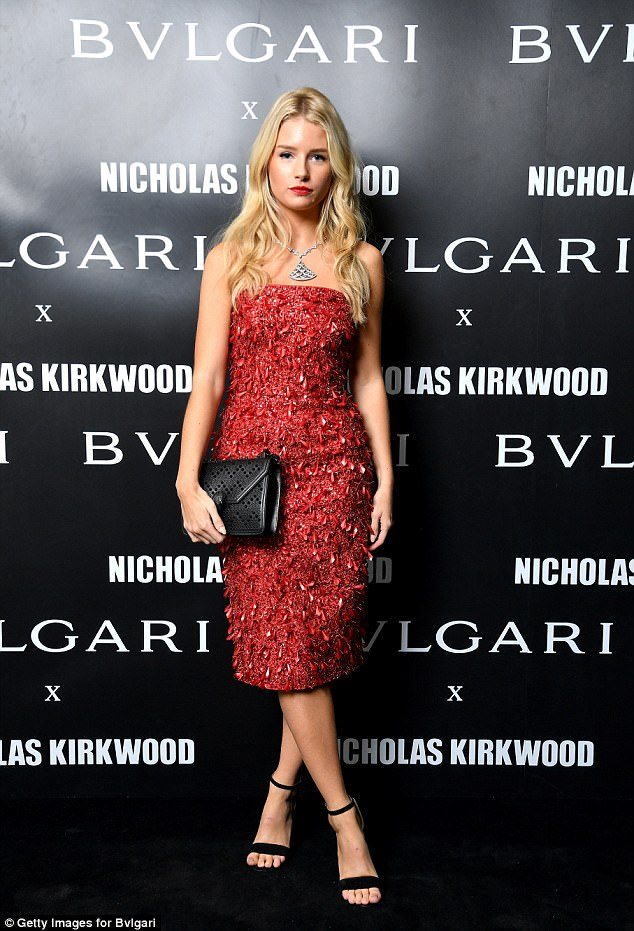 Lady in red: Lottie turned out for the Bvlgari bash in Italy on Wednesday night