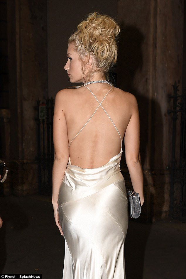 Bringing sexy back: Lottie's dressed backless, save for criss-crossing straps