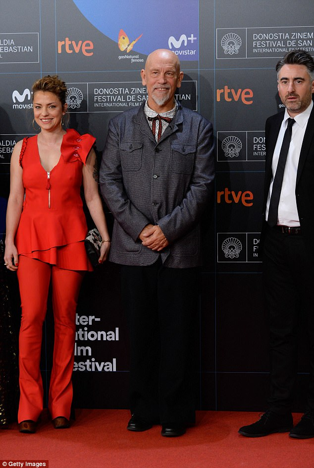 Suited and booted: Also in attendance was John Malkovich, who looked dapper in a grey blazer