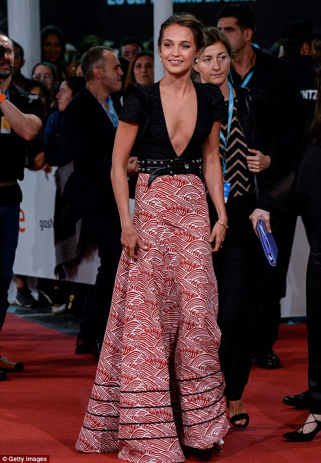 Turning heads: Alicia Vikander looked every inch the leading lady on Friday night, as she stormed the film's premiere during the 65th San Sebastian Film Festival in Spain