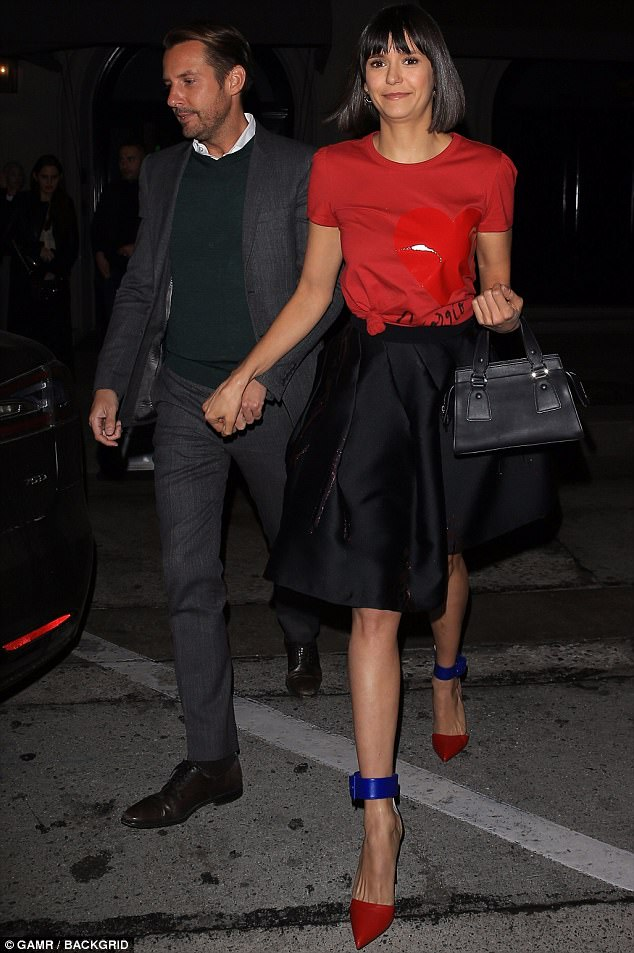 Hand-in-hand: Nina Dobrev enjoyed a cosy dinner with her publicist Gary Mantoosh in Los Angeles on Monday