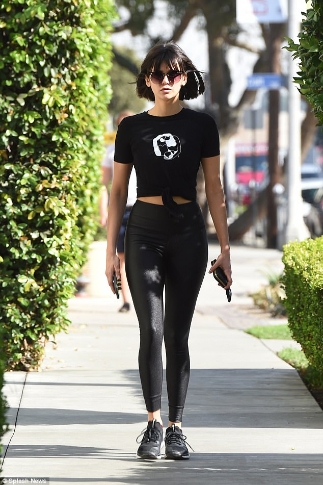 She can stomach it: She teamed her skintight look with a midriff baring tee