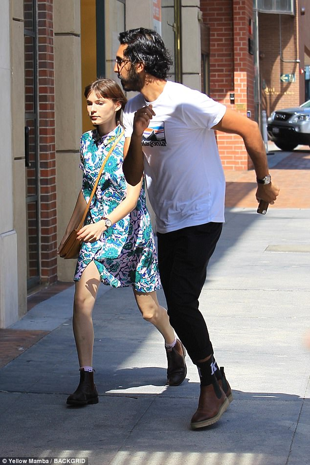 Happy: Dev Patel, 27, looked more loved up than ever with his leggy girlfriend Tilda Cobham-Hervey, 22, as the pair ran errands in Beverly Hills, California on Thursday