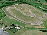Banking heir and racing enthusiast Alan Wilzing turned the backyard of his 150-year-old Dutch Colonial-style home in Taghkanic, New York, into a real-life, 1.15-mile-long, 40-foot-wide Formula One racetrack (pictured)