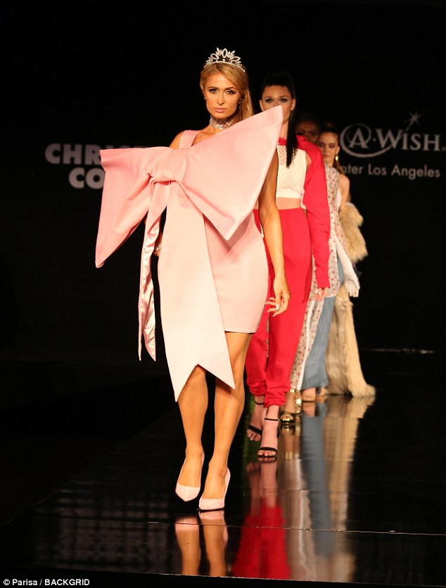 Pressie: Paris Hilton was a gift for the eyes in a giant pink bow dress as she hit the catwalk