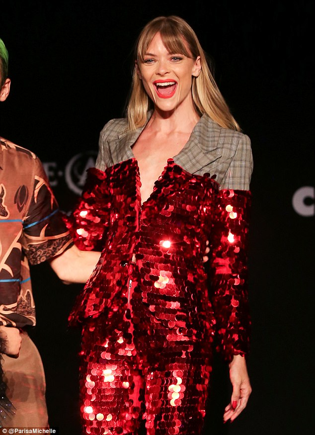 Red hot!Model Jaime commanded just as much attention as Paris, as she later hit the runway in an all-over sequin suit