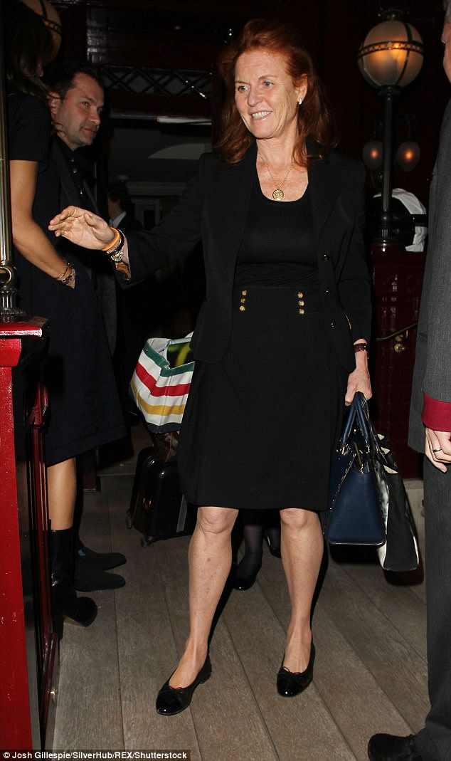 Fergie, the Duchess of York, looked trim in an all-black ensemble as she mingled with Gigi and Bella Hadid at Tommy Hilfiger's star-studded party