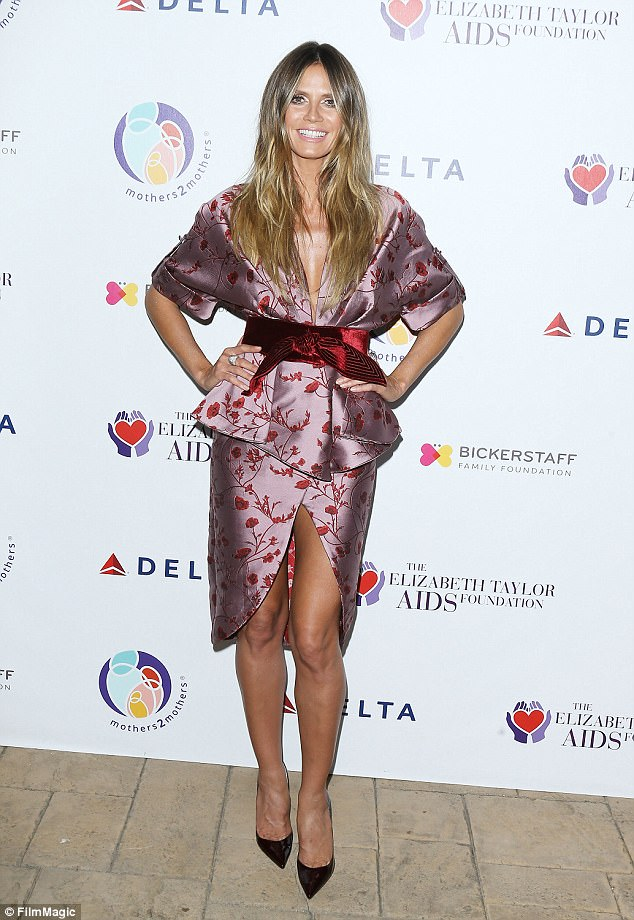 Gorgeous: Also supporting the cause was model and TV personality Heidi Klum, 44, who showed off her stunning figure in a silk kimono-style dress that revealed her long legs