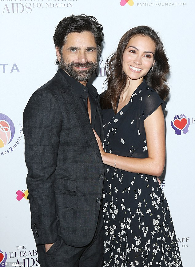 Newly engaged: On hand, too, was actor John Stamos, 54, and his new fiancee Caitlin McHugh, 31, and the couple put on a loved up display as they posed for photos