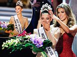 New Miss Universe Demi-Leigh Nel-Peters (left) is crowned by her predecessorIris Mittenaere of France on Sunday