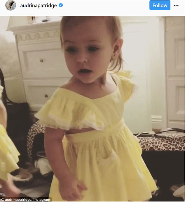 Proud mom: Sharing a video of their 14-month-old daughter Kirra, Audrina wrote: 'Light of my life This little beauty lights up the room wherever she is!'