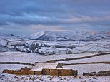 A winter vista looking across the upper Eden Valley as morning breaks with the first rays of sunlight clipping the snow covered Howgill Fells in Cumbria today.Commuters should expect milder temperatures than what we have experienced over this weekend on Monday, with parts of Southern England expected to reach double digit temperatures during the day