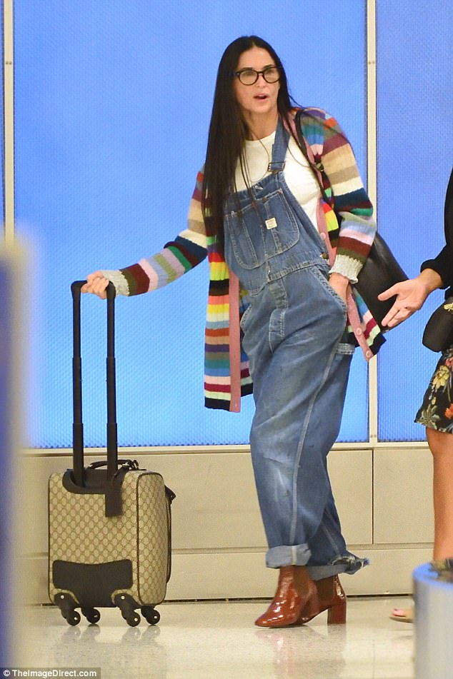 What's her secret? Evergreen Demi Moore, 54, looked as though she'd rolled back the years as she arrived at New York's JFK Airport on Thursday
