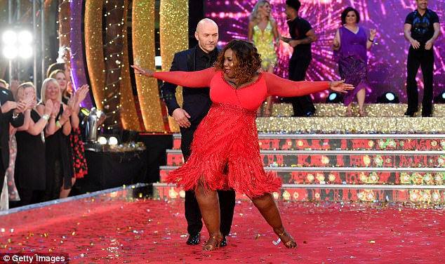 Fighting for the win: The Holby City actress was clearly keen to demonstrate her moves as Simon displayed his own