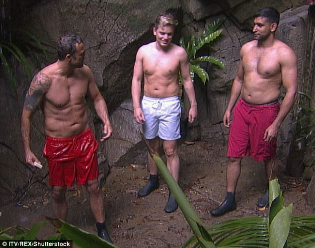 Jungle shower: The second snap reportedly shows Jack in a bathroom with his joggers pulled down to his knees with the photo taken on his camera phone (here with fellow contestants Jamie Lomas, left, and Amir Khan right)