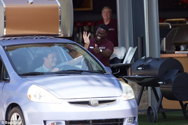 Rolling: But he was likely smiling just for a scene as he talked to a man in a silver car